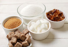 Sugar. White and brown sugar on the table royalty free stock photography