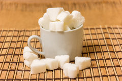 Sugar in a white cup Stock Images