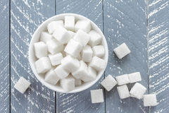 Sugar. White refined sugar in a bowl Royalty Free Stock Photography