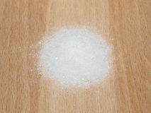 Sugar  on wooden plate Stock Photography