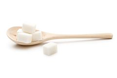 Sugar in a wooden spoon. On the white background Stock Photography