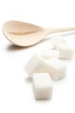 Sugar with wooden spoon. Cubes of sugar with wooden spoon Royalty Free Stock Images
