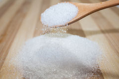 Sugar in the wooden spoon Stock Image