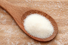 Sugar in a wooden spoon. Close-up Stock Photo