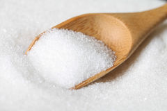 Sugar in a wooden spoon Stock Image