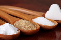 Sugar in wooden spoons Royalty Free Stock Photo
