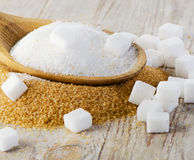 Sugar on wooden table Stock Images
