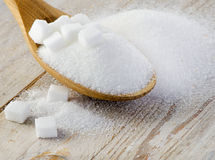 Sugar on wooden table Royalty Free Stock Image