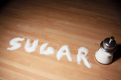 Sugar word. Sugar spelt out using sugar granules Royalty Free Stock Photos
