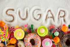 Sugar written on sugar powder. Close-up of sugar written on sugar powder on table royalty free stock image