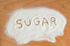 Sugar written on sugar powder Stock Photo