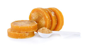 Sugarcane Hard Molasses or Jaggery and sugar in spoon Stock Photos