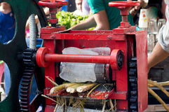 Sugarcane juice machine at a roadside stall in Delhi. Sugarcane juice machine used to extract fresh juice at roadside stall in delhi India Stock Photography