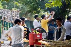 Sugarcane juice vendor extracting juice Stock Images