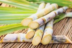 Sugarcane witn leaf on wood table Stock Photo