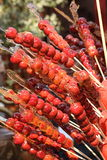 Sugarcoated haws on a stick Stock Images