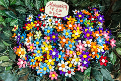 Sugared almond flowers. Daisy flowers crafted with couloured sugared almonds for sale. This is a speciality from Sulmona (in central Italy stock photography