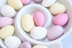 Sugared Almond Swirl. Sugared almonds in a white swirl dish stock photos