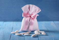 Sugared almonds for baptism. On the blue table royalty free stock photo