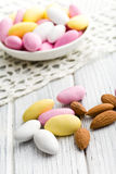 Sugared almonds. On kitchen table stock photography
