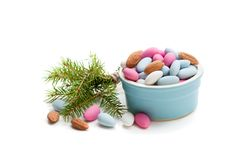 Sugared almonds on white background. Christmas dessert. royalty free stock images