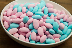 Sugared Almonds. On white bowl royalty free stock photography