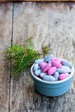 Sugared almonds on wooden table. Christmas dessert. royalty free stock images