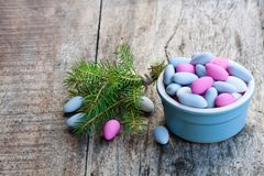 Sugared almonds on wooden table. Christmas dessert. royalty free stock photography