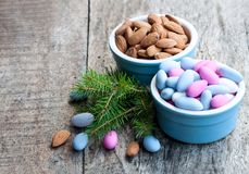 Sugared almonds on wooden table. Christmas dessert. royalty free stock photos