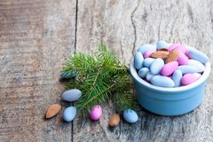 Sugared almonds on wooden table. Christmas dessert. stock photography