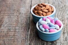 Sugared almonds on wooden table. Christmas dessert. stock images