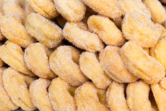 Sugared donuts texture. Cooking, asian kitchen, sale and food concept - sugared donuts texture stock image