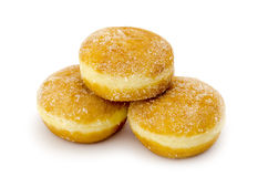 Sugared Doughnut. A pile of three Sugared Doughnut's isolated against white background stock photo