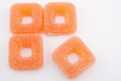 Sugared jellies. Orange squares - closeup Stock Images