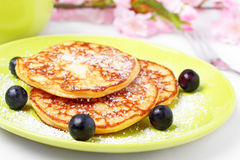 Sugared pancakes. Fresh pancakes with powdered sugar and blueberries stock image