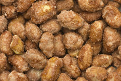 Sugared peanut pile background. Closeup royalty free stock images