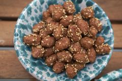 Sugared peanuts with sesame. As a snack royalty free stock images