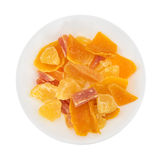 Sugared pineapple, mango and papaya on a white plate Stock Photography