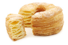 Sugared puff pastry donut with a cut piece Royalty Free Stock Photos