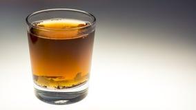 Sugared tea in a tea glass. Sugared tea in a transparent tea glass stock photos