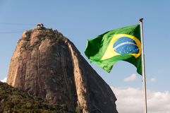 Sugarloaf Mountain and Brazil Flag Royalty Free Stock Photos