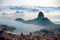 The Sugarloaf mountain in morning mist and Botafogo bay Royalty Free Stock Photos
