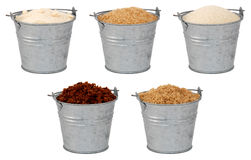 Sugars - caster, demerara, granulated, muscovado -. Sugars - golden caster, demerara, golden granulated, light and dark muscovado - in miniature metal buckets stock photography