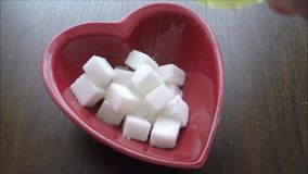 Sugars in a heart bowl. stock video footage