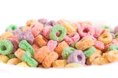 Fruity cereal in a bowl. Sugary and fruity cereal with different colors in a bowl with white  background Royalty Free Stock Image