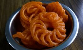 Sugary Imrati. A click of sugary and sweet Imrati Indian sweet pieces in a bowl stock photos