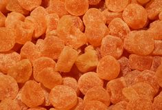 Sugary orange flavored candies. Lots of sugary orange flavored candies Stock Images