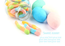 Sugary treats. Sweetened gummy candies and colored sugar eggs Royalty Free Stock Photos