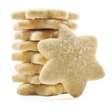 Suger revestiu bolinhos de shortbread em formas da estrela Foto de Stock