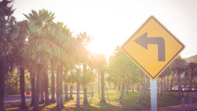Suggestion from traffic signs. Traffic signs point out to the sun light stock photos